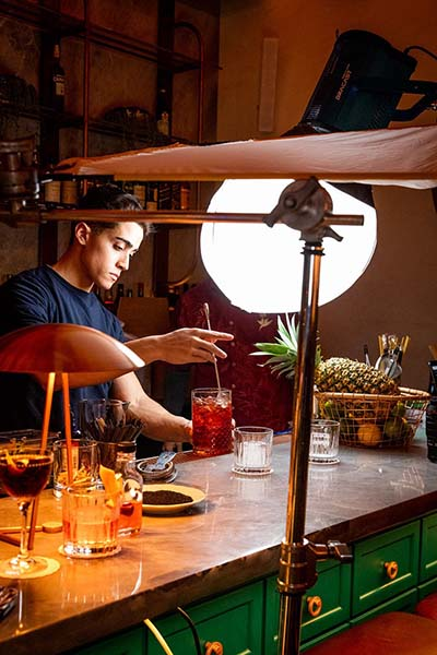 Behind the scenes of a bartender making a cocktail.