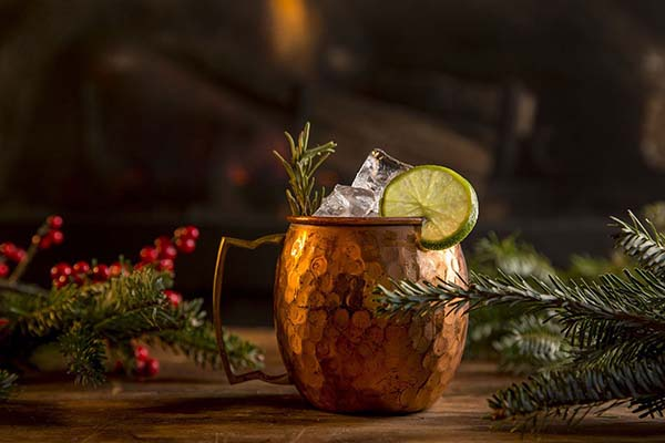 A festive holiday drink in a moscow mule cup by the fire at Antica Pesa in Brooklyn.